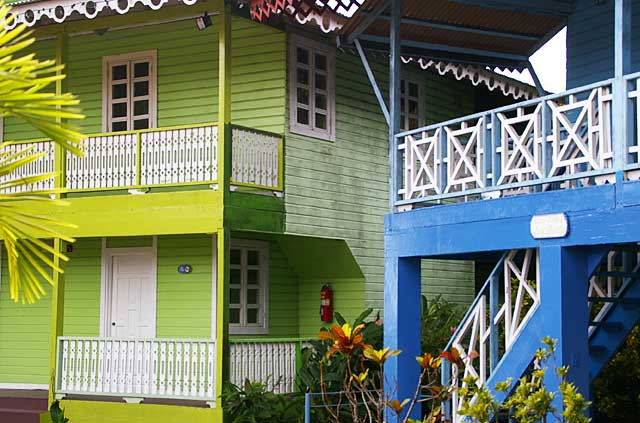 Example of caribbean style balconies on some colorful houses for Different building styles