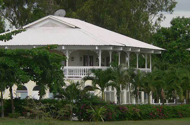 Photo example of a beach house built in a French Colonial Style with