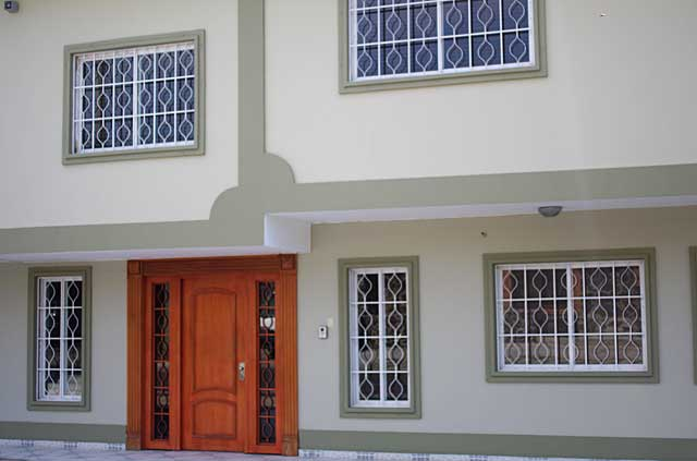 Example of one of my favorite house color combination with light creamy beige walls, light olive green  frames and light wood doors and   white window frames