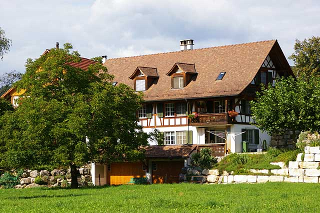 photo of a typical farm house in switzerland in the area