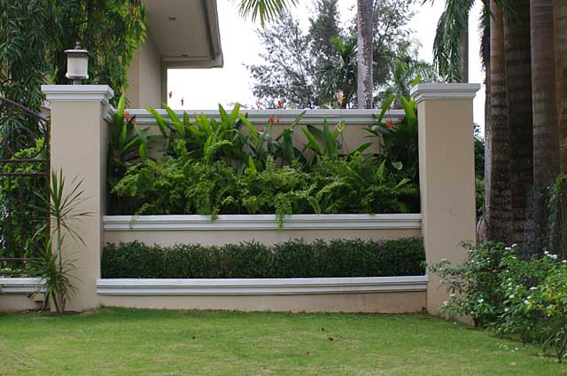 Photo example of a decorative fence or separator made of a for Decorative wall fence