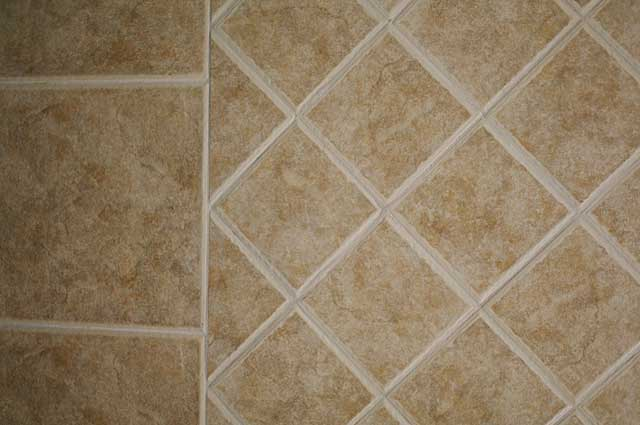 Photo Example of beige colored bathroom wall and floor tiles ...