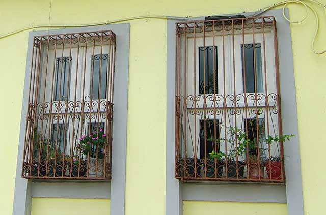 Image Some Simple But Decorative Metal Security Bars Covering The Windows  Of This House. These Metal Bars Leave Some Room Between The Window And The  Bars To ...