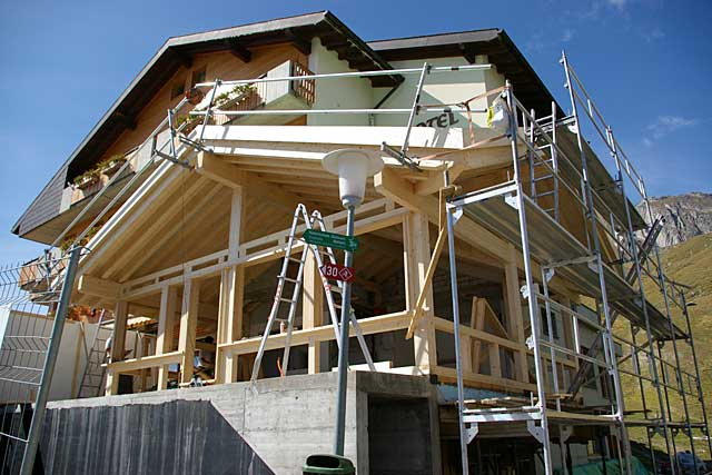Example of a traditional alpine chalet under construction for Stages in house construction