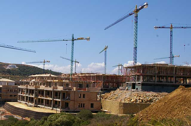 Example of a series of new homes under construction in a for Construction stages of building a house