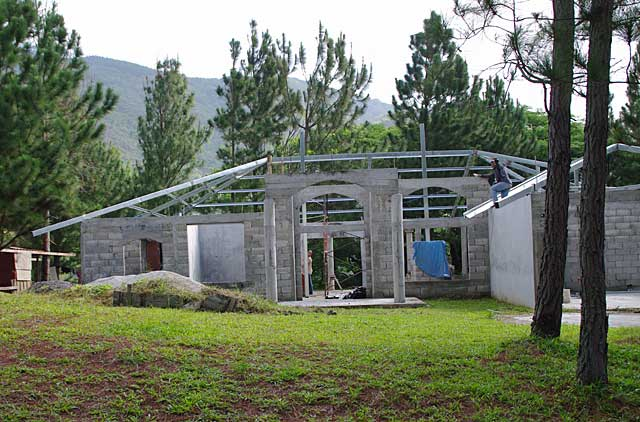 Example photo of a modern country house under construction for Construction stages of building a house