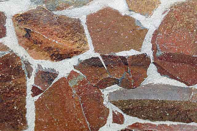 Example photo of a decorative stone wall in brick red tones with ...