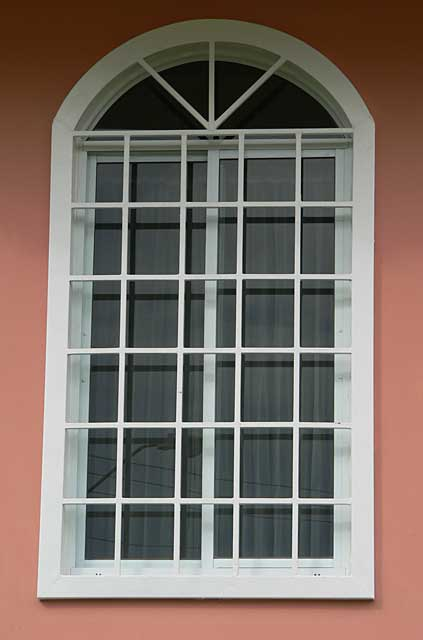 Photo example of a window with security metal square for Window styles for homes